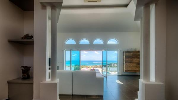 Stylish decor and fabulous sunrise view over Orient Bay