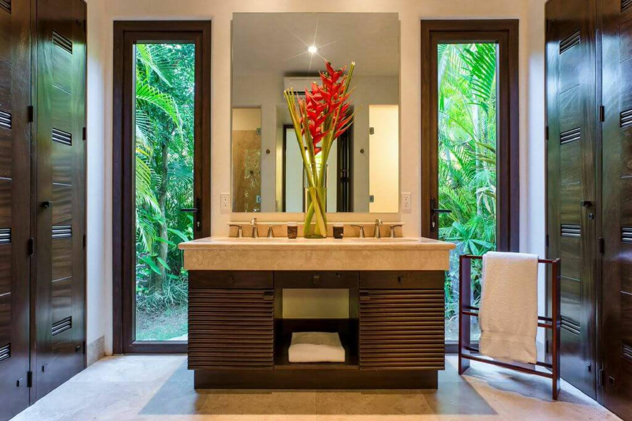 The bunk room bath features outdoor and indoor showers.