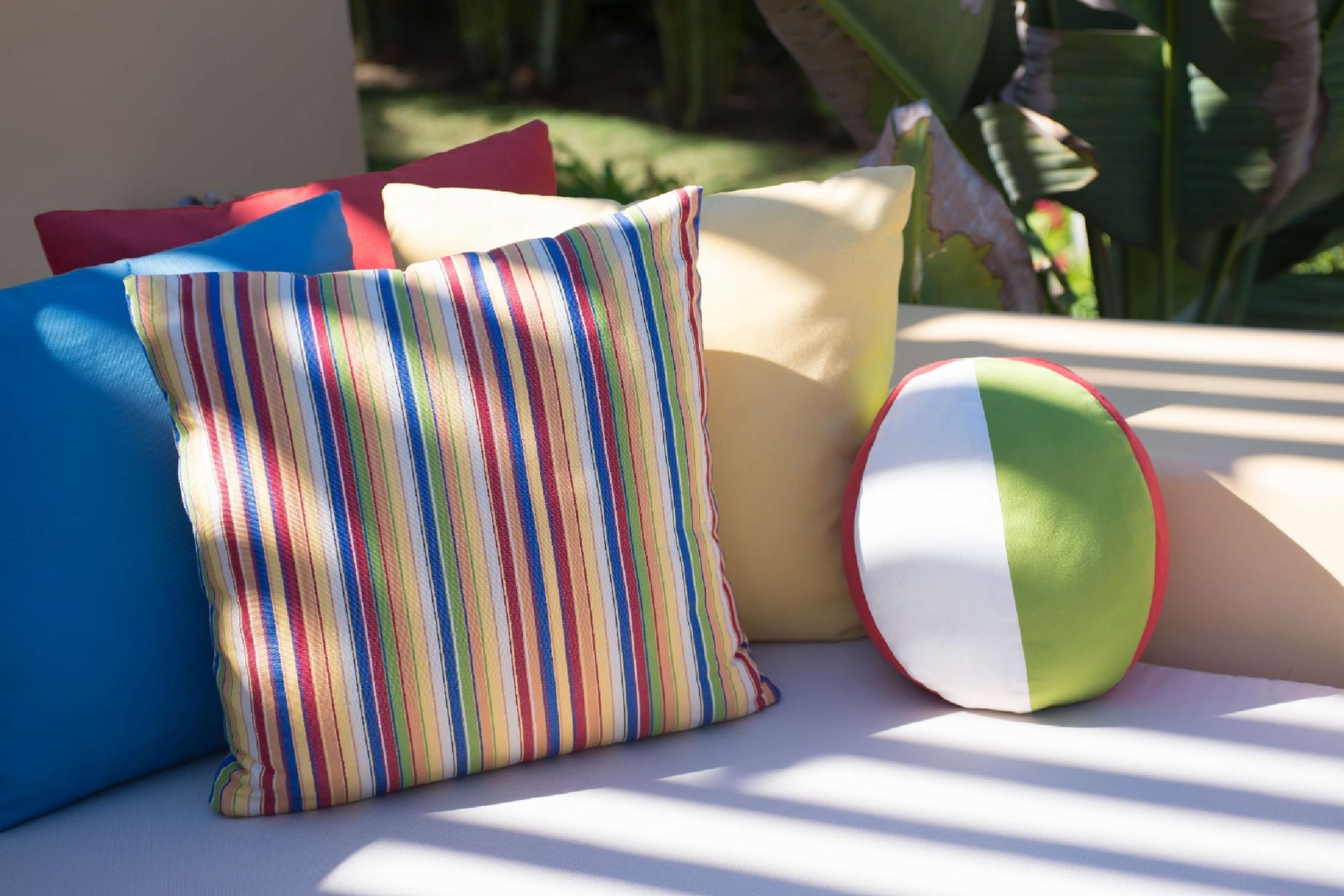 Colorful fabrics and comfortable seating areas abound.