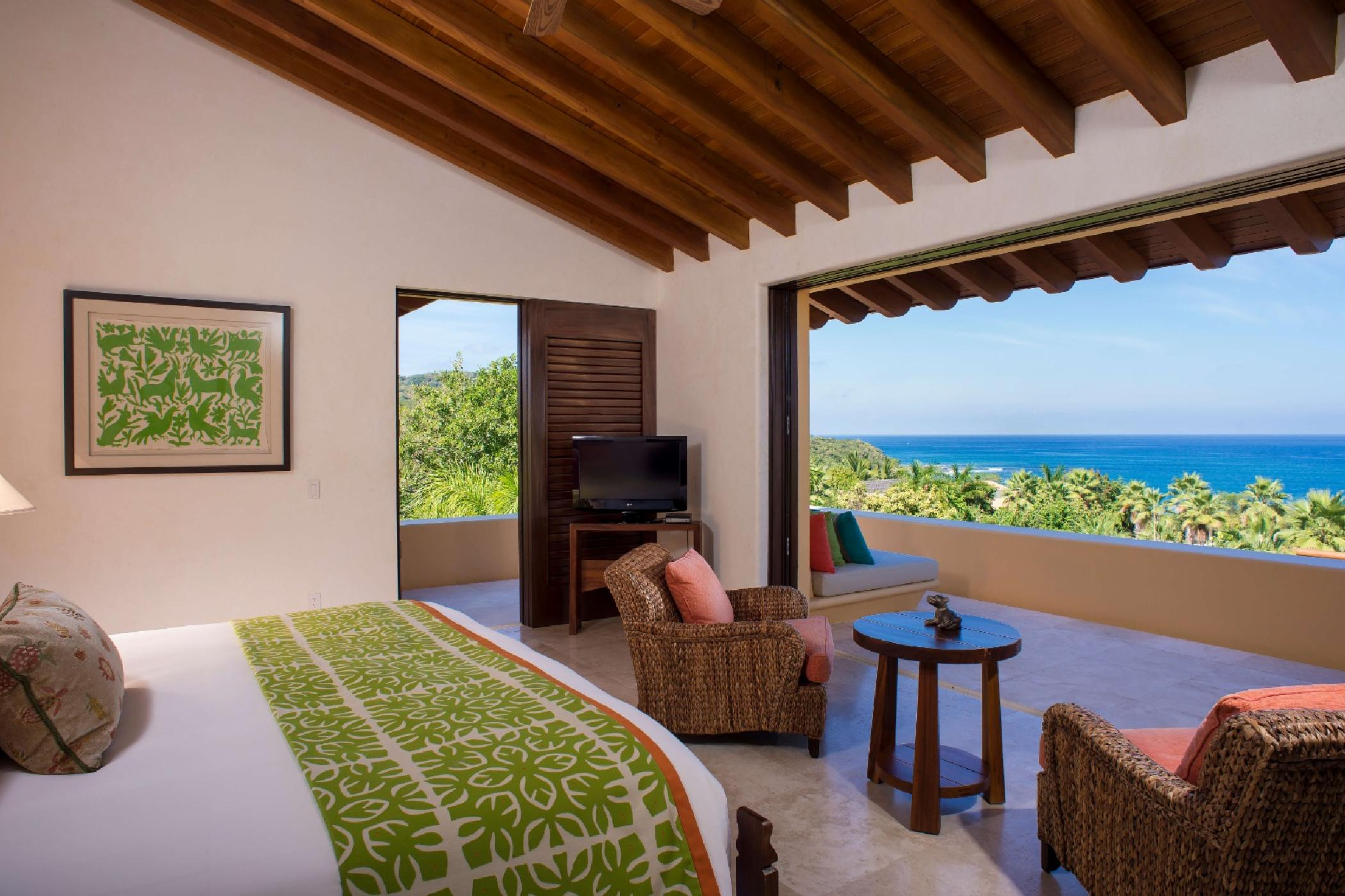 The master suite boasts uninterrupted views of the bay.