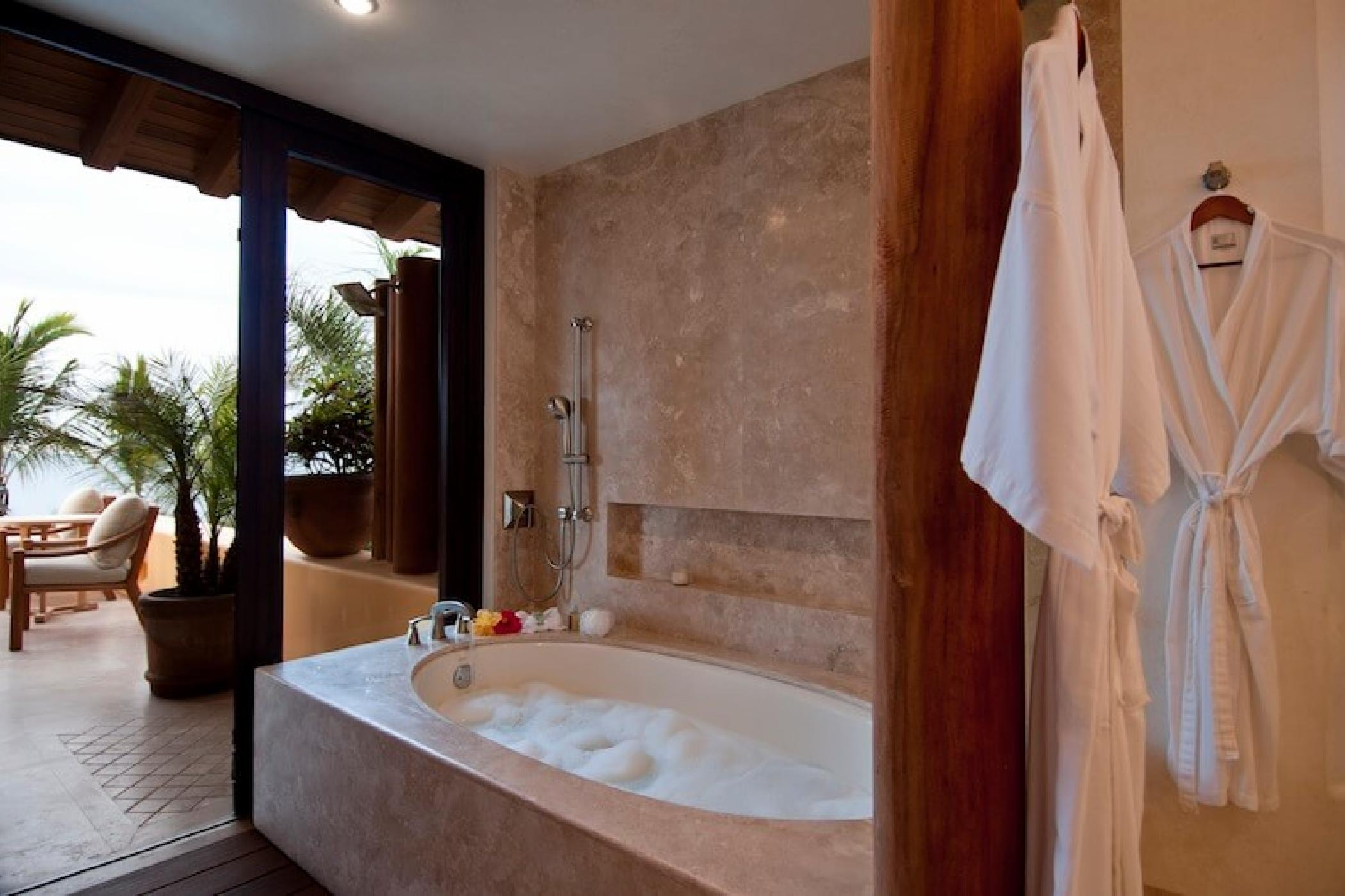 The master bath has indoor and outdoor showers.