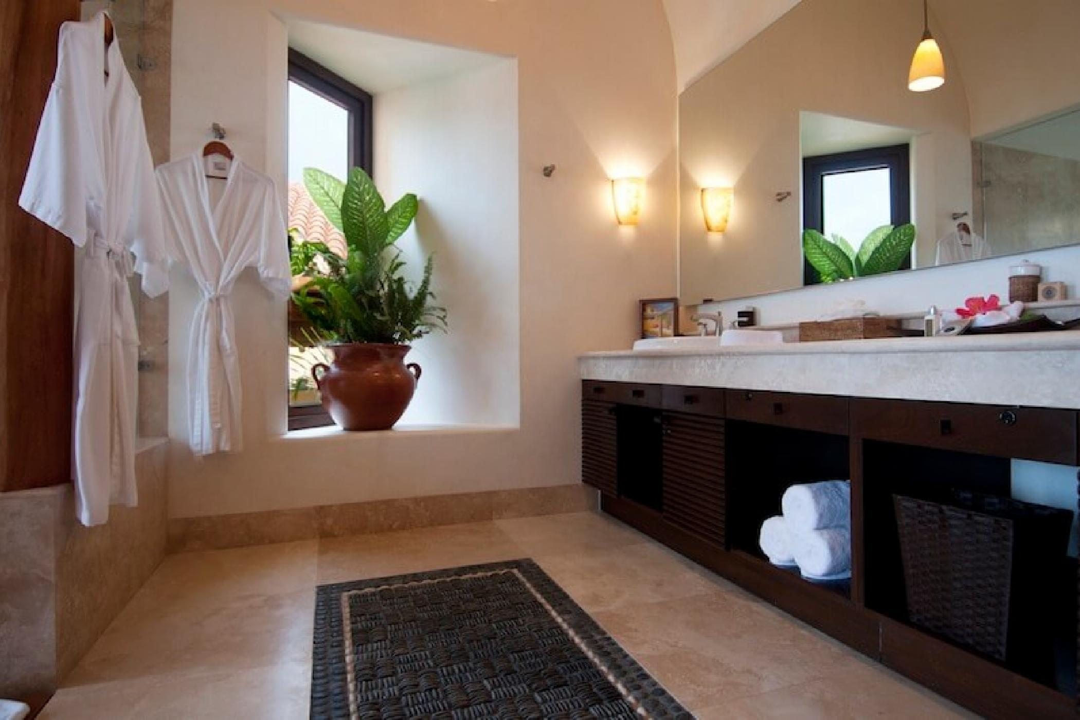 All rooms have ensuite baths with robes and luxurious soaps and shampoos.