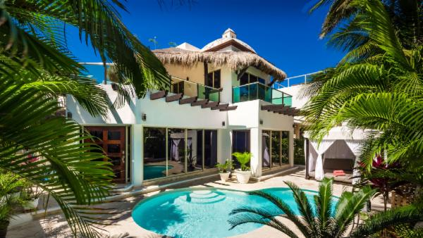 Playa del Carmen 5 BDR villa in exclusive gated community with rooftop sauna; rejuvenate with indoor/outdoor living, tropical pool, and nearby ocean amenities
