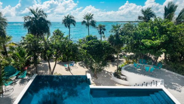 Stunning 6 BDR Tankah Bay 3 story seaside villa; private beach, incredible pool, luxury roof terrace, cinema room, personal gym