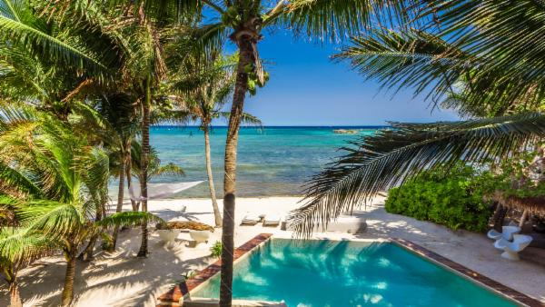 Open and airy 5 BDR Puerto Aventuras luxury oceanfront estate with pool, private butler & chef; Nature parks, scuba diving, snorkeling, and golfing