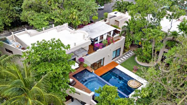 Playa del Carmen 7 suite luxury estate; Secure gated community, private master infinity pool, second pool in courtyard garden, luxury amenities, fully staffed