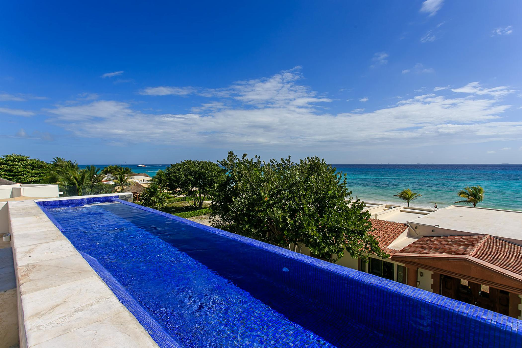 Private and secure Playa del Carmen 6 BDR villa; double pools, jacuzzi, panoramic ocean views, family game room