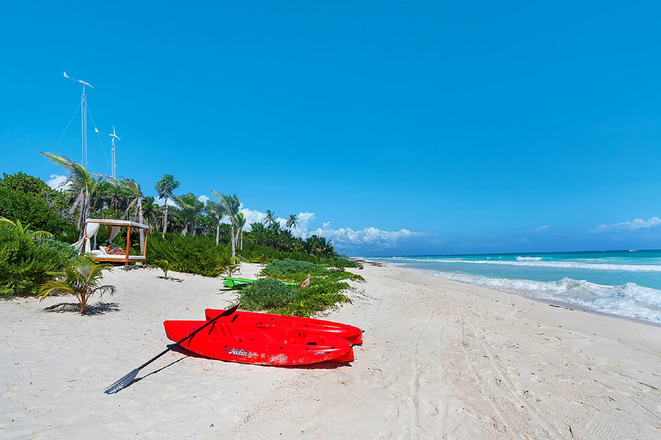 Private ocean & lagoon frontage 4 BDR Sian Kaan villa; plunge pool, water activities, eco-friendly
